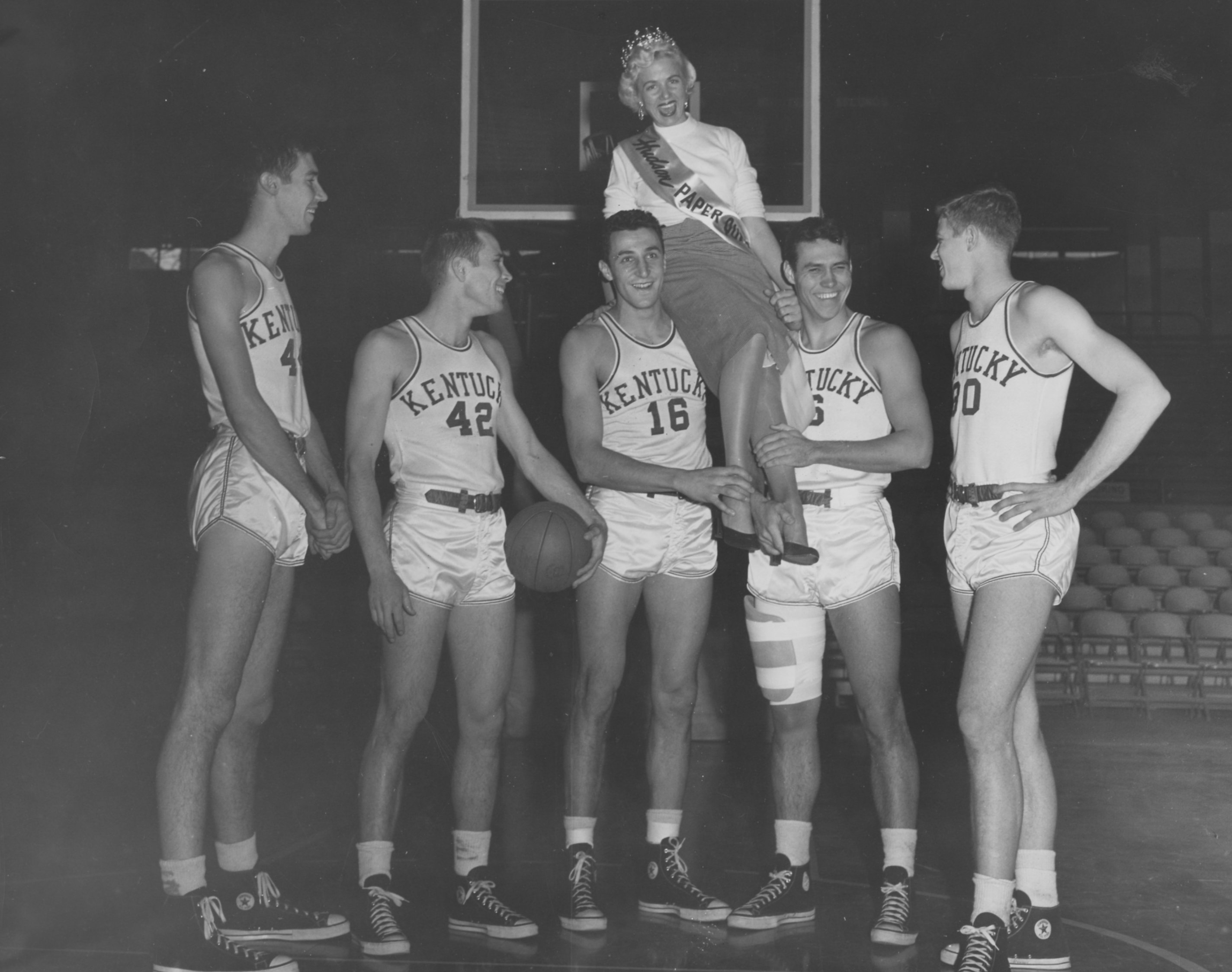 Basketball team members Lou Tsioropoulos 16 pictured holding