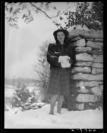 Campus views (1940 Kentuckian) (University of Kentucky), Woman standing next to stone (rock) wall