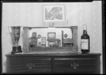 Theodore Moore, Chevy Chase Apartments (865 Tates Creek Pike), Interior, Dollhouse, golf trophy, and bottle of whiskey on top of bureau (dresser)