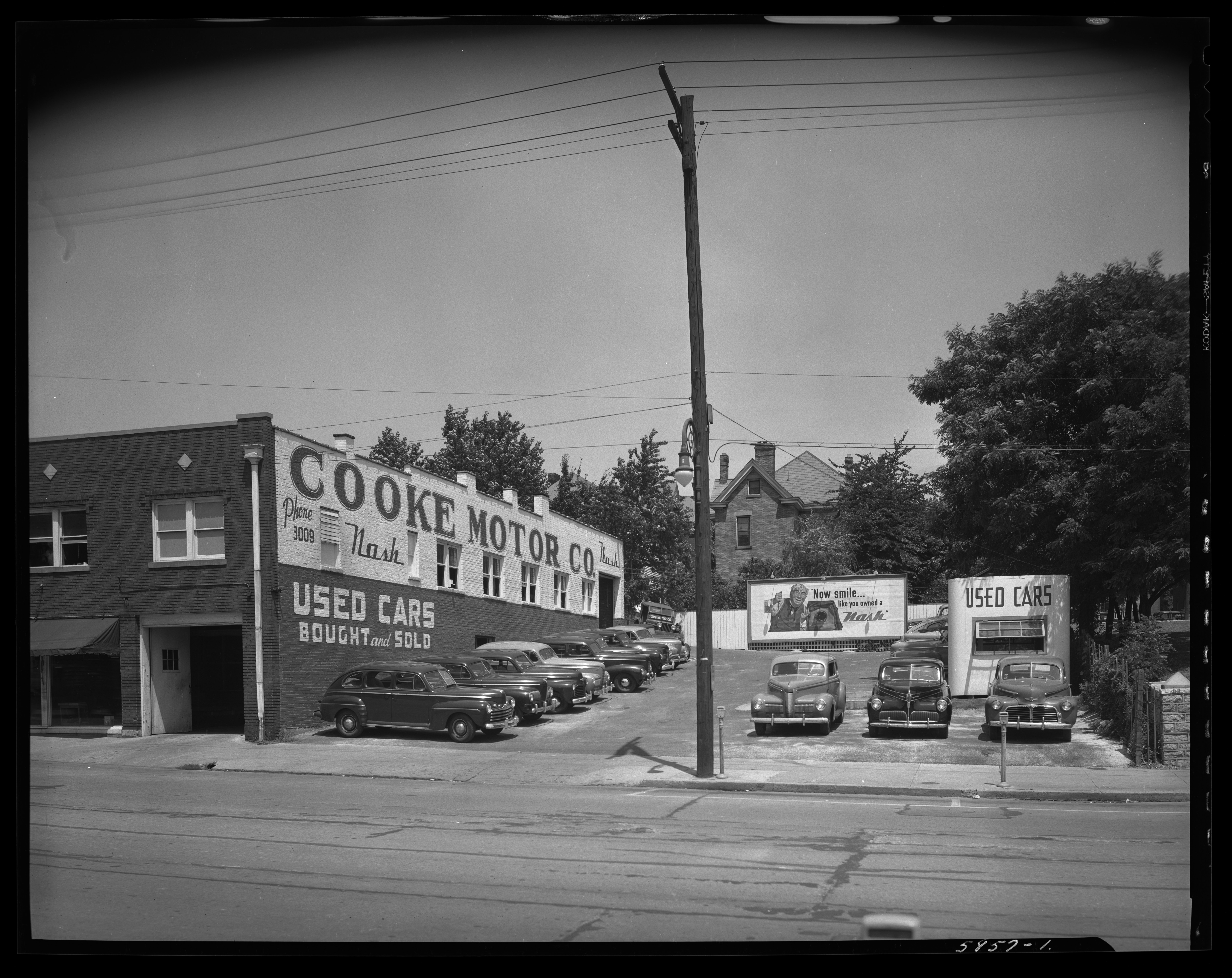 """L.R. Cooke Chevrolet Company, 255 East Main; used car lot; side of building reading """"Cooke Motor Company"""", 1947"""